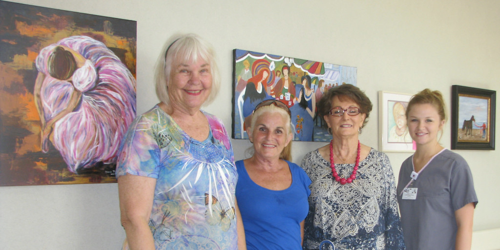 Local artists visit with staff member Gwen Bradley, CNA, as they hang a new art exhibit at Ozark Health Medical Center. Shown (from left) are Joyce Hartmann, Mary Shelton, Doris Sexson and Gwen Bradley.