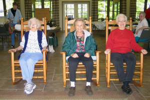 Rock'n'Roll: This photo (taken by Choctaw resident Joyce Hartmann at Mt. Eagle) was the inspiration for her painting. Rocking are (from left) Fairfield Bay residents Melva King, Dorothy Hendrickson and Ruby Krimm.  In the background are (left) Sandra Ellis and Bonnie Hookman, all at Mt. Eagle.