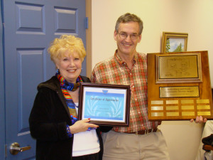 Pictured above, Willa is presented the Volunteer of the Year Award by Mayor Paul Wellenberger.
