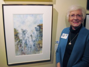 "Diana Foote stands next to her award-winning watercolor ""Seaside Waterfall"" at the Mid-Southern Watercolorists Exhibition in Little Rock. (photo by Mike Foote)"