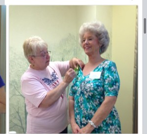 Ten yr KOPS lady, Pam Hickman, receives her award from TOPS leader, Rebecca Giannini.
