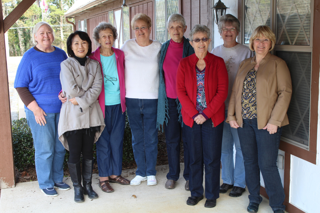 Several members of the North Central Arkansas Artist League stand in front of Bayside Studio in Old Towne Fairfield Bay: (from left) Jan Cobb, Yun Kim, Jeanne Homuth, Ellen Kelly, Carolyn Goettsch, Ann Snyder, Joyce Hubbard, and Joan Bland.