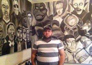 Nelson Scott shown with his black & white mural