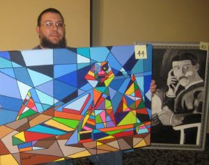 Nelson Scott with some of paintings at the NCA Art Gallery