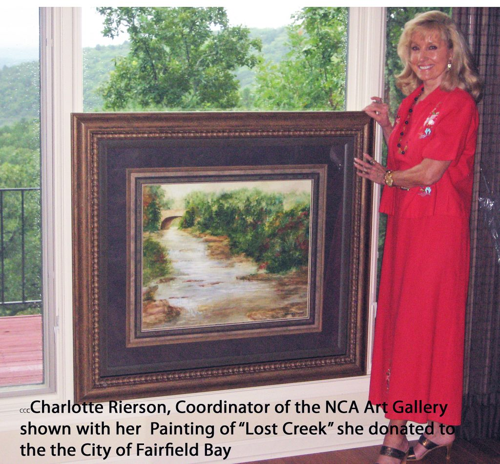Charlotte with her painting of Lost Creek