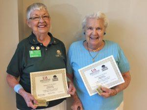 Barbara Danks and Ingeborg Bauer receive their Lifetime 15 Year Pins.
