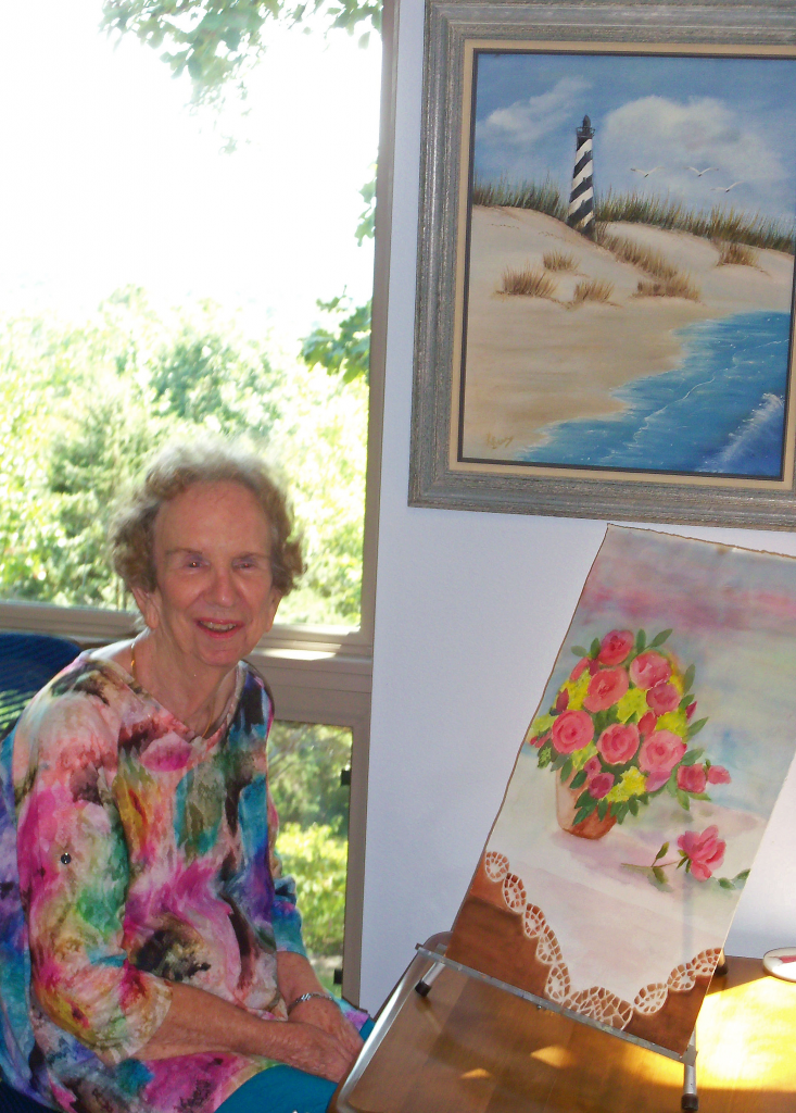Shown in photo is Lea getting ready for the new exhibit in the NCA Art Gallery/ Fairfield Bay Conference Center Oct. 24
